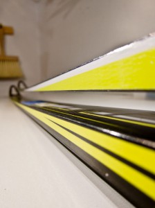 A couple of generations of HM skis with their distinctive flat sidewalls