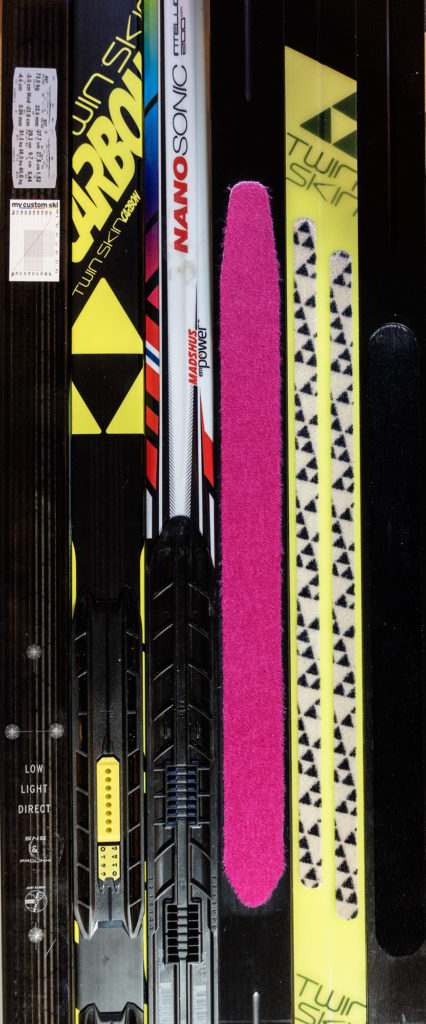 Inexplicably, this is the only picture we've got of the Salomon S/Race Skin skis. The other skis pictured here are the Madshus Nanosonic and the Fischer Twinskin Carbon. You can clearly see the very pink Pomoca skin on the Salomon ski, and you can also see the relative length and position of the inlay in the various different models. Of course, this all depends on the camber configuration of the skis themselves.