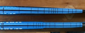 Rear end bridge markings at 2kg load increments. New skis are above, and current model is below. Further mark to the right is 10kg on each pair.